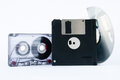 Disk tape and floppy disk on white background Royalty Free Stock Photo