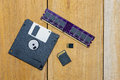 Diskette sd card micro sd card and memory were put together on wood board Royalty Free Stock Photography