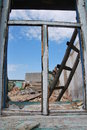 Dismantle of a window frame old in the shabby destroyed house overlooking the sky ladder and brick heap Stock Images