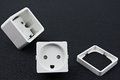 Dismantled electrical outlet Stock Images