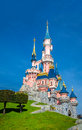 Disney castle disneyland paris paris france th march image of the disneyland castle in the sunshine and blue sky in paris france Royalty Free Stock Photo