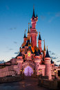 Disneyland Paris Castle illuminated at sunset Stock Photos
