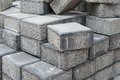 Disordered stockpile of gray square pavement bricks Royalty Free Stock Images