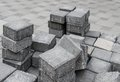 Disordered stockpile of gray square pavement bricks Royalty Free Stock Image