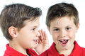 Dispatch child photographic portrait of two children whispering in your ear Royalty Free Stock Images
