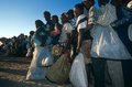 Displaced people receiving aid in a camp in Angola Stock Images