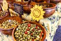 Display of assorted types of olives for sale Royalty Free Stock Photo