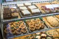 stock image of  A display case full of desserts and pastries
