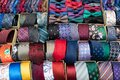 Display of different patterns and colours of man ties in a shop or showroom Royalty Free Stock Photo