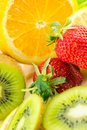Display of fresh fruit on brightly coloured background close up Stock Photos