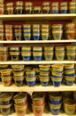Display of glazed ceramic pottery in a market colorful on shelves Stock Photo