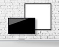 Display on a table and blank picture frame Royalty Free Stock Photo