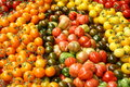 Display of tomatoes large a variety colourful on a market stall Royalty Free Stock Photo