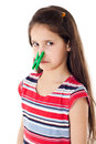 Displeased girl with clothespins on his nose isolated white Stock Photography