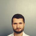 Displeased man with empty copyspace portrait of above his head Stock Images