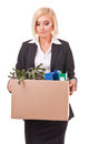 Displeased secretary with her personal things young business woman holding a box of belongings and documents Royalty Free Stock Image