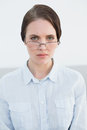 Displeased woman wearing eye glasses portrait of a young Stock Photo