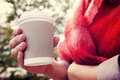 Disposable coffee cup young woman drinking from Royalty Free Stock Image