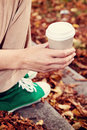 Disposable coffee cup young woman drinking from Stock Photo