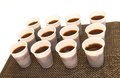 Disposable cups with coffee lots of Royalty Free Stock Photo
