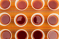 Disposable cups with tea lots of on a colorful background Stock Photos