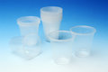 Disposable cups transparent with blue background Stock Images