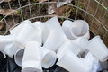 Disposable plastic cups on open container Royalty Free Stock Photo