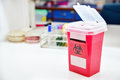 Disposal container; reducing medical waste disposal.