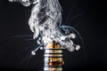 Dissassembled electronic Cigarette vape explosion Royalty Free Stock Photo