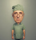 Dissatisfied bighead doctor in uniform over grey background Stock Image