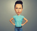 Dissatisfied cartoon girl with big head over dark background Royalty Free Stock Photos