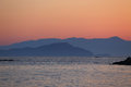 Distant mountains at dusk seascape view Royalty Free Stock Photography