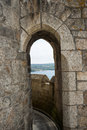 Distant view through arch rural stone archway Stock Photo