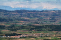 Distant view of pyrenees and windmills from miramar viewpoint in tarragona spain Stock Photo
