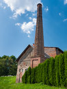 Distillery building old brick of with a tall chimney Stock Image