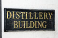 Distillery sign on a building producing bourbon or whiskey Stock Image