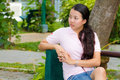 Distracted woman in park Royalty Free Stock Images