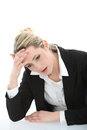 Distraught young businesswoman Stock Photo