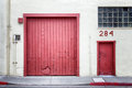 Distressed red doors backdrop or background alley Stock Photo