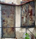 distressed wall with rusty panels