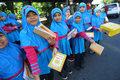 Distribute religious books islamic schools while welcoming ramadan in the city of solo central java indonesia Royalty Free Stock Image