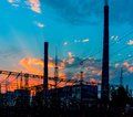 Distribution electric substation with power lines and transformers, at sunset. Royalty Free Stock Photo