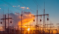 Distribution electric substation with power lines and transformers, at sunset Royalty Free Stock Photo