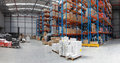 Distribution warehouse with high rack shelving system panorama Royalty Free Stock Photo