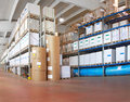 Distribution warehouse with paper rolls and material for printing Royalty Free Stock Photography