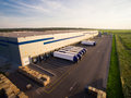 Distribution warehouse with trucks of different capacity Royalty Free Stock Photo