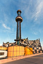 District heating vienna austria april chimney of the most famous in of artist hundertwasser in intensive afternoon light on Stock Images
