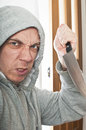 Disturbed violent burglar concept portrait of a in a home Royalty Free Stock Photo