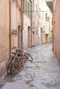 Disused bikes in the streets of pisa italy Stock Photography