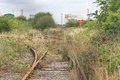 Disused railway track old rail leading to a oil refinery Royalty Free Stock Image